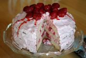 Strawberry Dream Cake with a big strawberry on top, on a real cake plate