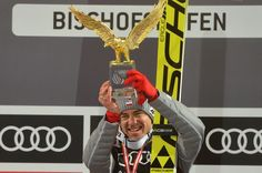 Kamil Stoch of Poland celebrates with the trophy at the podium for the Four Hills tournament's overall winners after the final stage of the 65th Four Hills Tournament (Vierschanzentournee) ski jumping event in Bischofshofen, Austria, on January 6, 2017.  .Polish double Olympic champion Kamil Stoch secured the Four Hills ski jumping tournament with his final effort to land glory at Bischofshofen. / AFP / Michal CIZEK Ski Jumping, January 6, Olympic Champion, Austria, Poland, Olympics, Effort, Skiing, Stage
