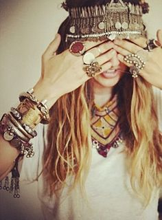 so many chunky bracelets and rings. Plus a killer headband and hippie hair