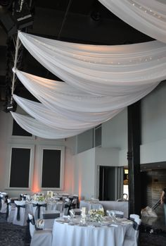 White ceiling drapes. Styled by Greenstone Events.