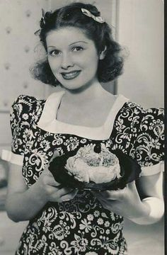 A young Lucille Ball with dark hair