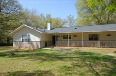 Country living retreat only 15 minutes to UF/Shands. This pool home is ready for you. Brand new roof, completely custom renovated bathrooms,...