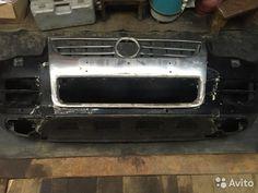 Передний бампер, решетка радиатора. Touareg 2009