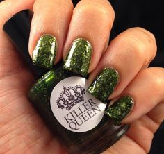 Killer Queen'O Fir Tree Dear' is a green jelly polish packed with gold flakies to create a look reminiscent of a lit up Christmas tree. This polish takes on a different look in various lighting and can be worn past the Christmas holiday.
