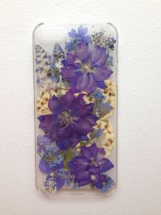 flowers pressed by hand and then carefully constructed in a rubber wrap around case.