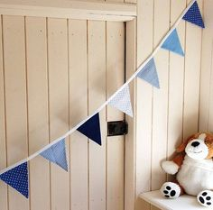 Handmade cotton bunting. Looks gorgeous strung across boys bedroom and can be personalised with name - makes a lovely unique gift!    For personalised bunting please allow 2-3 weeks as they are made to order. Quality blue fabrics used in stripes, dots and ginghams. This bunting would look great in boys bedroom or for a party or christening. 3 meters in length and all flags are double sided and made to last.
