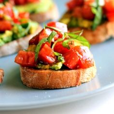 Smashed Avocado + Tomato Basil Bruschetta. A healthy appetizer ready in 10 minutes.