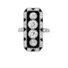 Art Deco Diamond and Black Onyx Ring, circa 1920. How cool is this?
