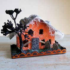 Vintage Putz Style Spooky Lighted Halloween Retro Glitter House Ornament with Giant Rats Tombstones. $28.00, via Etsy.