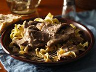 Classic Beef Stroganoff. First, I did make this with deer instead of beef so I actually cooked my meat in an iron skillet in bacon grease, then transferred the meat to the other pan. I also made this gluten free (minus the egg noodles) by using 2 TB Argo corn starch instead of 1/4 c. flour. I did add some white wine, and it was delicious! YUM! My family ate this with the egg noodles, I used gluten free pasta. Oct. '13