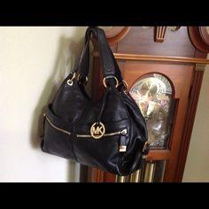 Michael Kors Handbag Genuine leather. Gold hardware. Interior, zips, slip, cell phone. Color: black Michael Kors Bags
