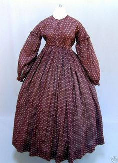 1860s cotton gathered bodice dress with bishop sleeves.