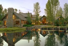Gorgeous log home on a lake in Wyoming.  Love the setting!
