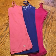 ☀️☀️3pc. Summer tanks☀️☀️ 3 Summer tanks. Blue one has beading across the top. Magenta one also has some light beading across the top. Salmon colored one is plain. All are in excellent condition. Barely worn. All are Aeropastale. Aeropostale Tops Tank Tops