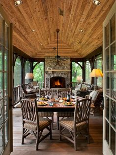 Rustic outdoor porch at the campy Lake home retreat - what a fabulous space!