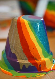 Rainbow-Pour Painted Pots (http://blog.hgtv.com/design/2013/02/21/daily-delight-rainbow-pour-painted-pots/?soc=pinterest)