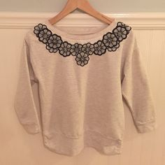 """Anthropologie Sat/Sun Flower Appliqué Pullover EUC  Saturday Sunday from Anthropologie    Flower applique, lightly fleece lined, 3/4 sleeve pullover. Loose fit. Small side ruching.    Size XS, also fits S    Excellent used condition!    Cotton & Polyester    Bust: 19"""" across the front, lying flat. Has stretch!    Length: 23.25"""" from shoulder to hem.  ✳️ Bundle to Save 20%!  ❌ No Trades, Holds, PP   100% Authentic!    Suggested User // 900+ Sales // Fast Shipper // Best in Gifts Party Host…"""