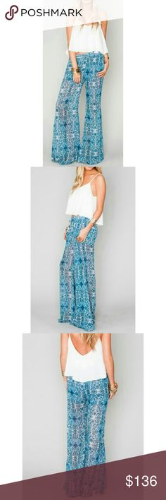 Coming Soon Show Me Your Mumu Tass Party Pants Santorini Print  No time to make it to Greece this year? No worries, Santorini Splash will do the trick! Her intricate pattern will hypnotize passer-bys. With her dark and light blues and tiniest red details you?ll feel like the coolest tile work you?ve seen has come to life and needs you to show her off to the entire world. Perfect buddy to go exploring with and have adventures!?  Price will be $99 Show Me Your MuMu Pants Wide Leg