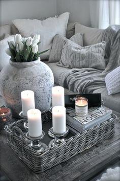 Gray cottage decor.  Sofa, table, throws, pillows