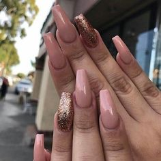 Beautiful nude coloured long acrylic nails with glitter. So ardorable!
