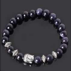 Sparkling Dark Blue Sandstone Buddha Bracelet Beautiful, high quality and new bracelet featuring dark blue sandstone beads and silver beads. Stretchy. One size fits all. No flaws. Let me know if you have any questions! Jewelry Bracelets