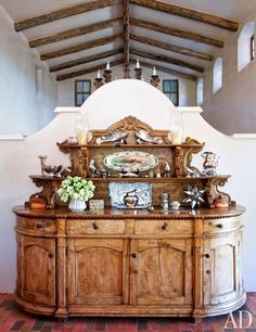 The kitchen's carved-walnut buffet is 19th-century Peruvian; it stands against a divider replicated from a California mission.
