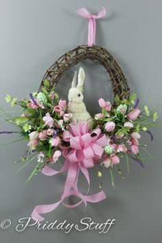 Egg shaped wreath w/ Pink Tulips, gingham colored eggs and one straw bunny.