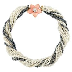 .Cultured and Black Cultured Pearl Torsade Necklace with Carved Coral and Diamond 'Rose de Noel' Clasp, Van Cleef & Arpels
