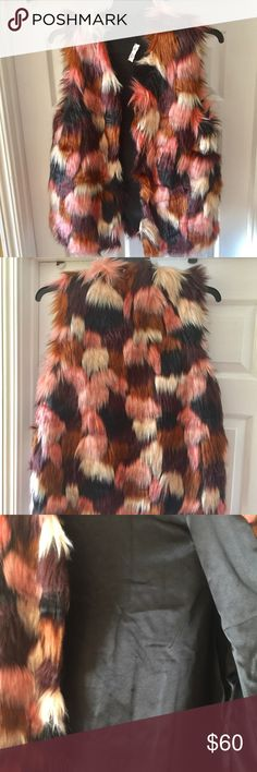 "NWT. Sassy Faux Fur Jacket This beautiful lined jacket is soft and sassy.  Stunning patch colors of chocolate brown, pink, bride and black.  Pair with leggings and boots and Or a dress with thigh high boots!  Also rock with jeans and nice shirt. So many ways to style. A MUST HAVE!   One Size  29in length  Bust 21"" across  Material 100% Acrylic   Bundle and save 15% Top Rated Seller Same Day/ Next Day Shipping Reasonable Offers Welcome ❌ Trades or Paypal❌ TBB Boutique Jackets & Coats"