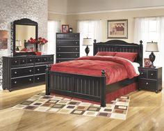 The Jaidyn Poster Bedroom Set from Ashley Furniture HomeStore Wood Bedroom Furniture, Furniture Sale, Bedroom Decor, Bedroom Ideas, Furniture Ideas, Black Bedroom Sets, King Bedroom Sets, Master Bedroom, Cheap Bedroom Dressers