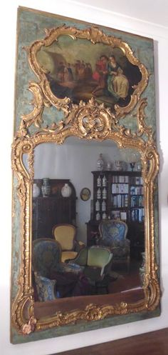 A Louis XV carved and gilt wood pier mirror with painted panel - France - 18th century and later