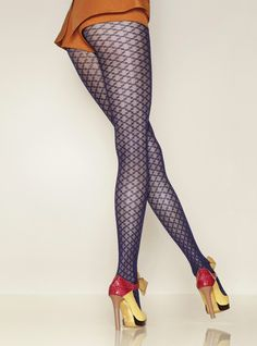 Bold geometric design adds a twist to the fishnet tight. Made in France by Gerbe.