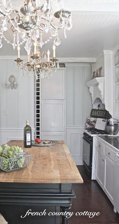 luv the double chandeliers in the kitchen.
