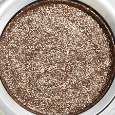 Urban Decay Diamond Dog Moondust Eyeshadow Review, Photos, SwatchesApplied dry, the payoff was semi-sheer, but it intensified to mostly opaque color when applied with a damp brush. When using a damp brush, it does help to minimize fall out during application (not entirely but certainly less than if applied dry).
