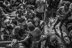Francesco Zizola - 2016 Photo Contest | World Press Photo   In the Same Boat Contemporary Issues, second prize stories August 26, 2015  A wooden fishing vessel sails from Libya to Italy carrying more than 500 migrants.