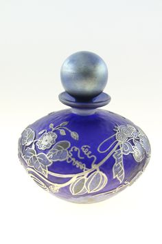 A perfume bottle with cameo relief and enamel by the glass artist Jonathan Harris.