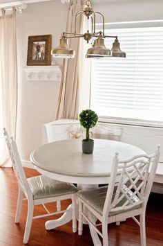 White and grey table Love the breakfast nooks also