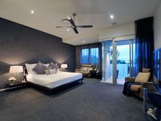 Classic bedroom design idea with carpet & balcony using black colours - Bedroom photo 186894