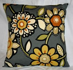 gray, and with the mod floral and the golds and reds, this pillow is a favorite.red couch?