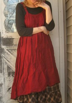Wear layers -- brown plaid aline skirt with ruffle , long sleeve simple top and a contrasting bold dress = fall/winter layers with red linen dress