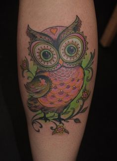 Fabulous owl watercolor tattoo on calves for woman