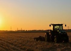 Plowing the field at sunset