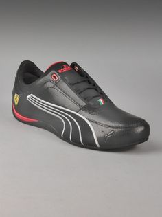 Puma® Ferrari Drift Cat IV Mens Carbon Shoes in Black.  These Puma Ferrari sneakers are truly something special. Sleek black sneakers have a low profile, a striking Puma outline on the side of each shoe, and the Puma Ferrari logo. Inspired by motorsports, and sporting red and white accents - a great pair of Puma mens shoes.