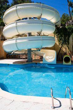 Swimming Pool With Water Slide Stock Image - Image of bucket, nobody: 25360477