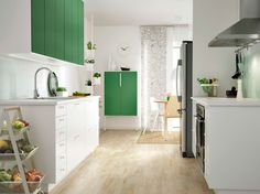 I like the white and green cabinets, especially the freestanding one against the wall by the clock