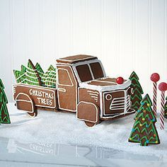 Vintage Trucks Get the family together to make this vintage truck at the Christmas tree lot - a fun and whimsical gingerbread project that will appeal to both young and old, plus it's easy for little hands to decorate. - Canadian Living is the Christmas Tree Lots, Christmas Gingerbread House, Christmas Treats, Christmas Baking, Gingerbread Cookies, Christmas Cookies, Christmas Decorations, Gingerbread Houses, Italian Christmas