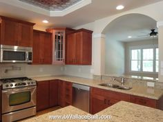 light granite countertops and brown cabinets in this Madison