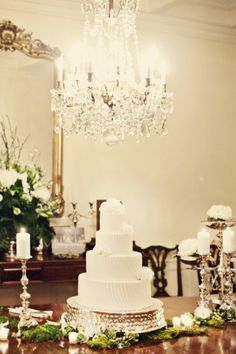 Classic black tie wedding cake with a gorgeous chandelier overhead