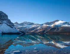 Perfect reflection in Bow Lake along the Icefields Parkway in Alberta Canada.  _  We loved every minute of our 14-day road trip around Alberta in 2015 but this view would have to be one of the highlights.  #ExploreCanada  _  Today we're leaving Mexico and flying to New Hampshire for a short trip in the White Mountains followed by a stopover in Boston and then a week in Alaska. August looks like it will be a big month!  _  As we're travelling we stay connected with @tepwireless. In fact I'm…