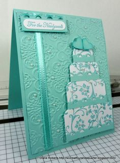 handmade celebration card ... monochromatic aqua ... gorgerous multi-layer cake ... baroque embossing folder texture on main layer ... luv it!!